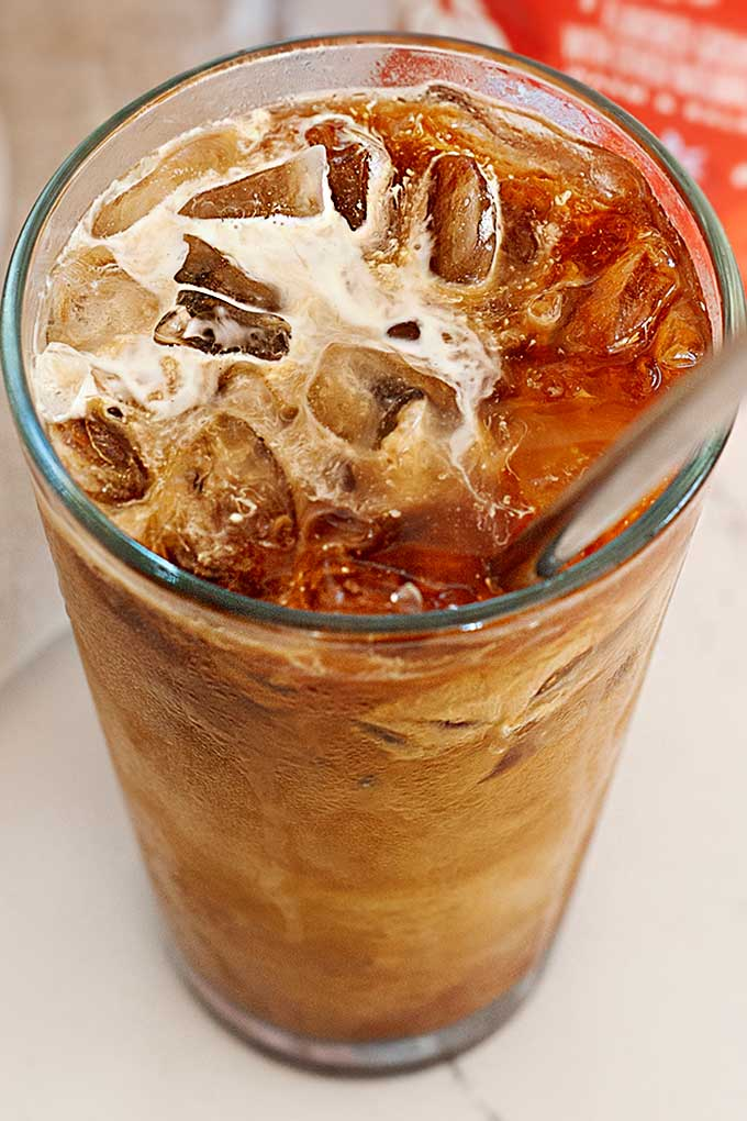 image: overhead view of iced coffee in a glass