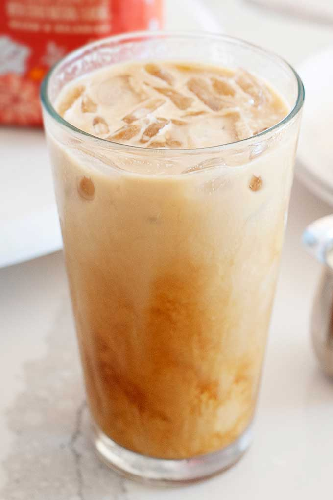 image: side view of glass filled with instant iced coffee and cream.