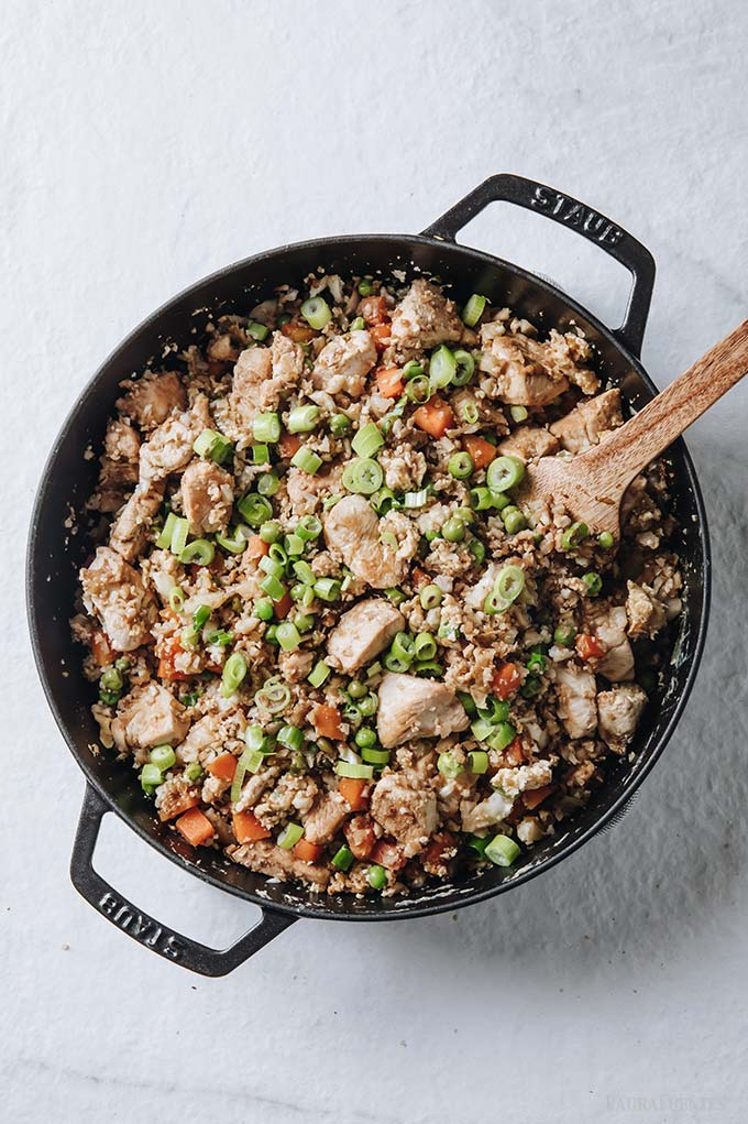 image: overhead view of skillet filled with healthy chicken fried rice.