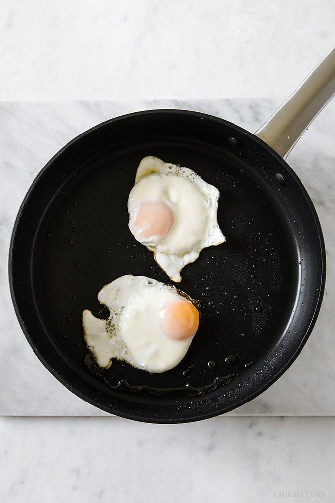 image: two sunny side up eggs in a skillet