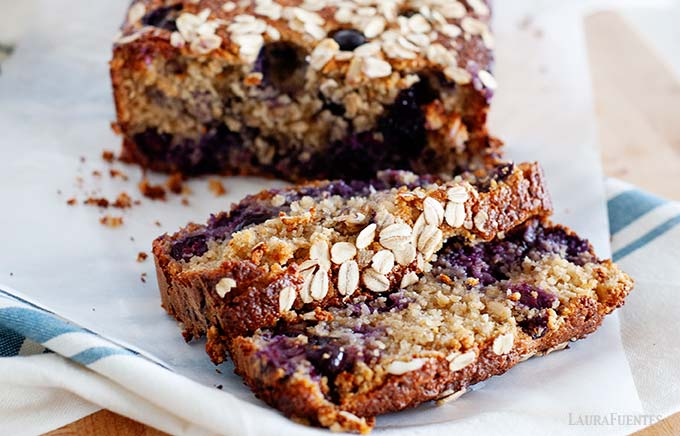 image: closeup view of blueberry bread slices cut from the full loaf
