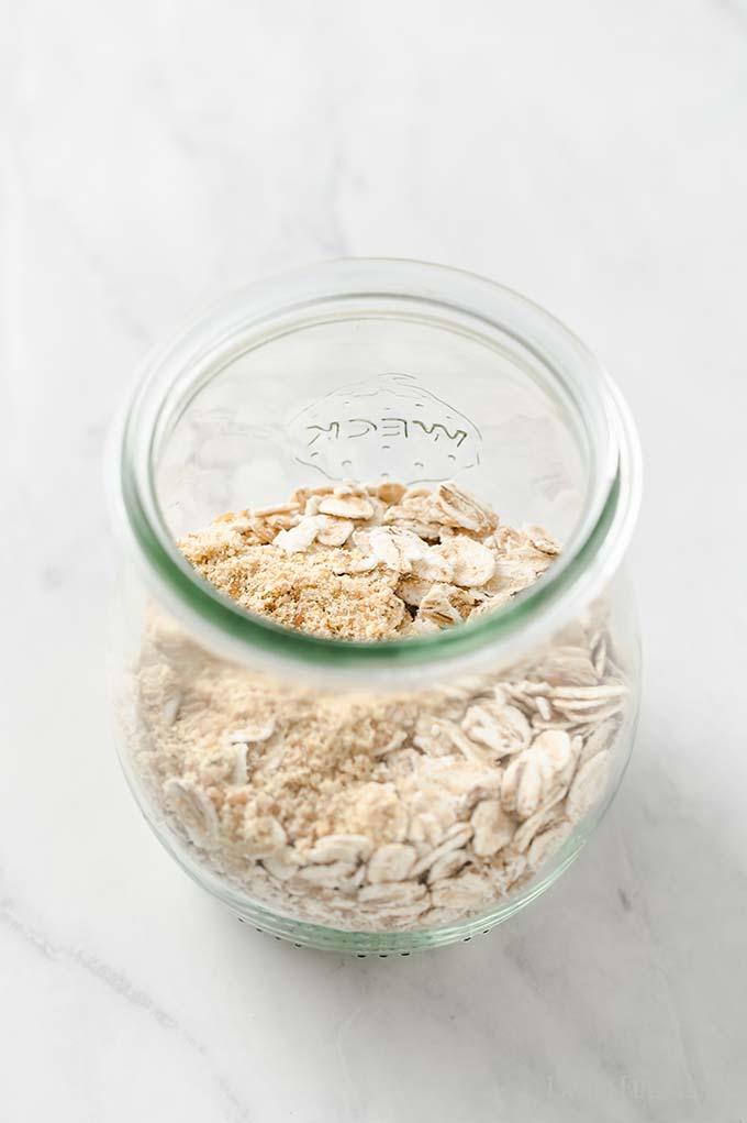 image: oats in a small glass jar.