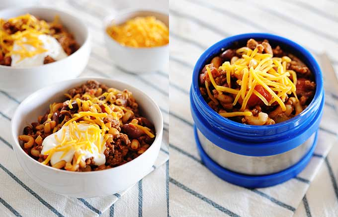 img: chili mac in a bowl topped with sour cream and cheese and in a thermos container.