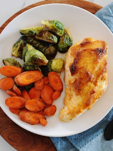 chicken breast and vegetables on a plate
