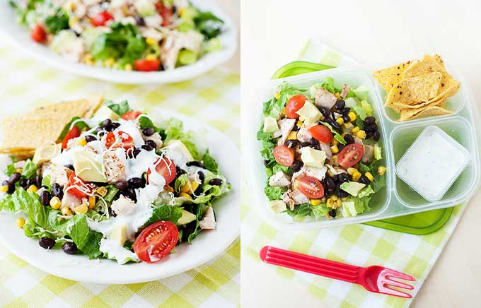 image: big bowl of salad topped with black beans, corn, chicken, avocado and tomatoes drizzled with salad dressing. the same santa fe salad inside a lunch container.