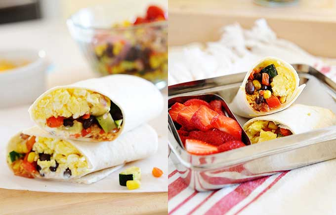 img: southwest burritos with eggs and veggies on a wooden board and inside a lunch container with strawberries.
