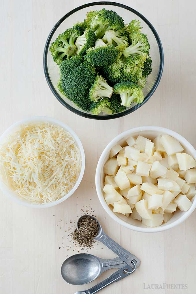 small bowls of ingredients for broccoli tots, including broccoli cheese and spices.
