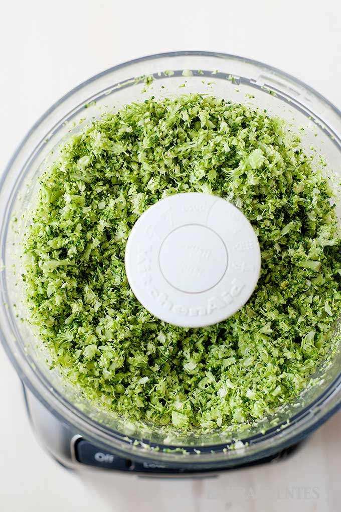overhead view of broccoli, cheese and potatoes blended in a food processor