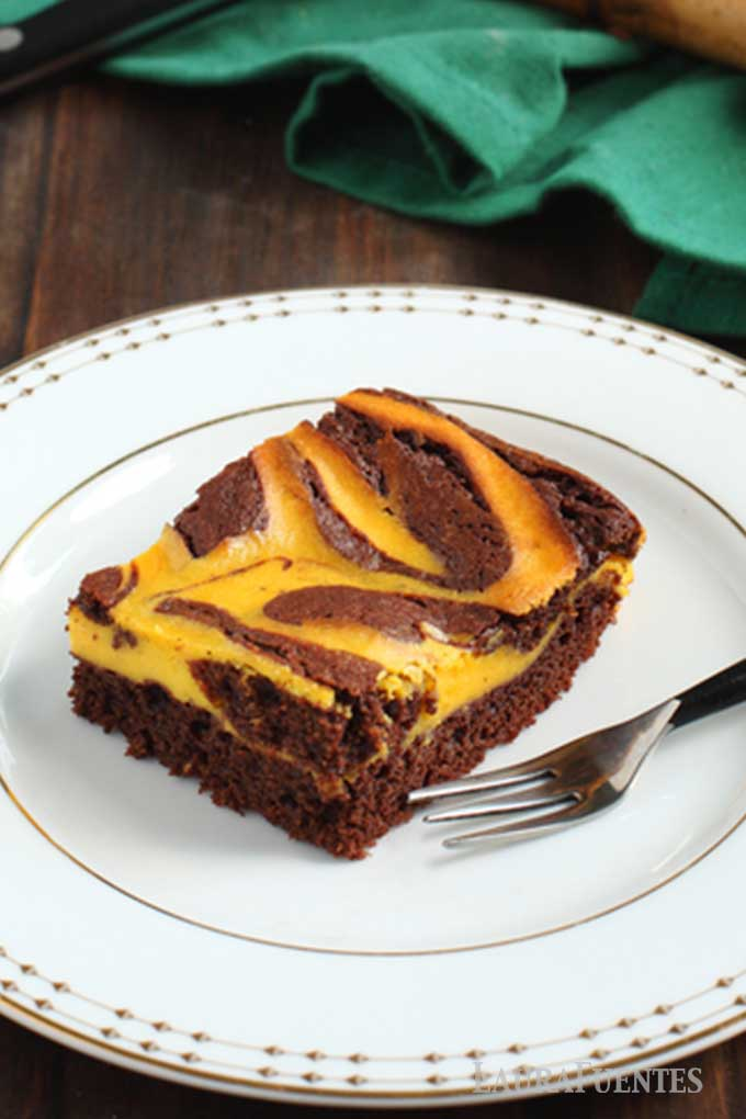 one brownie with pumpkin swirl on a plate