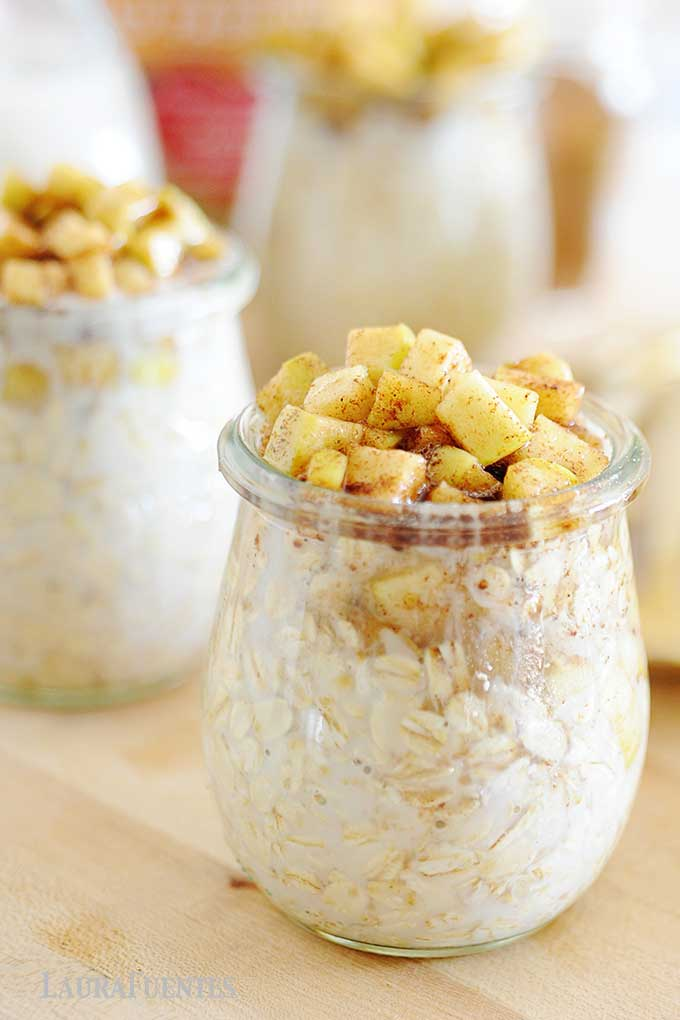 closeup of jar of overnight oats topped with cinnamon apples