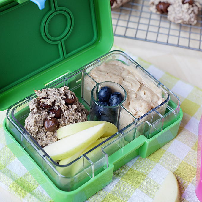 snack box with dip, a cookie and sliced apples