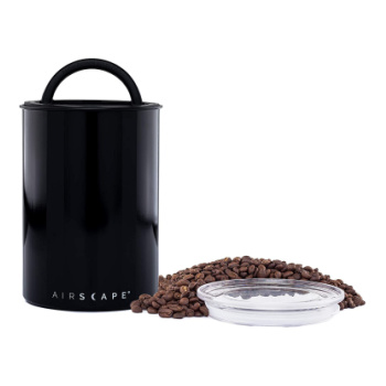 black canister with coffee beans and seal lid next to it