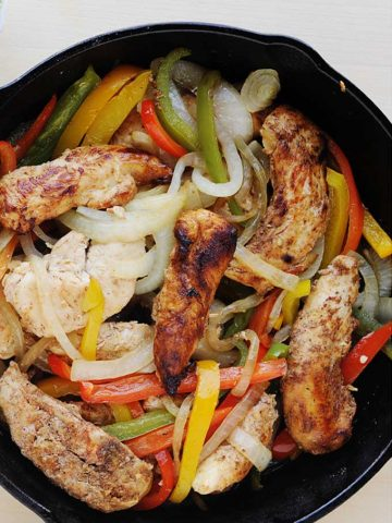 skillet of chicken strips, roasted peppers and onions