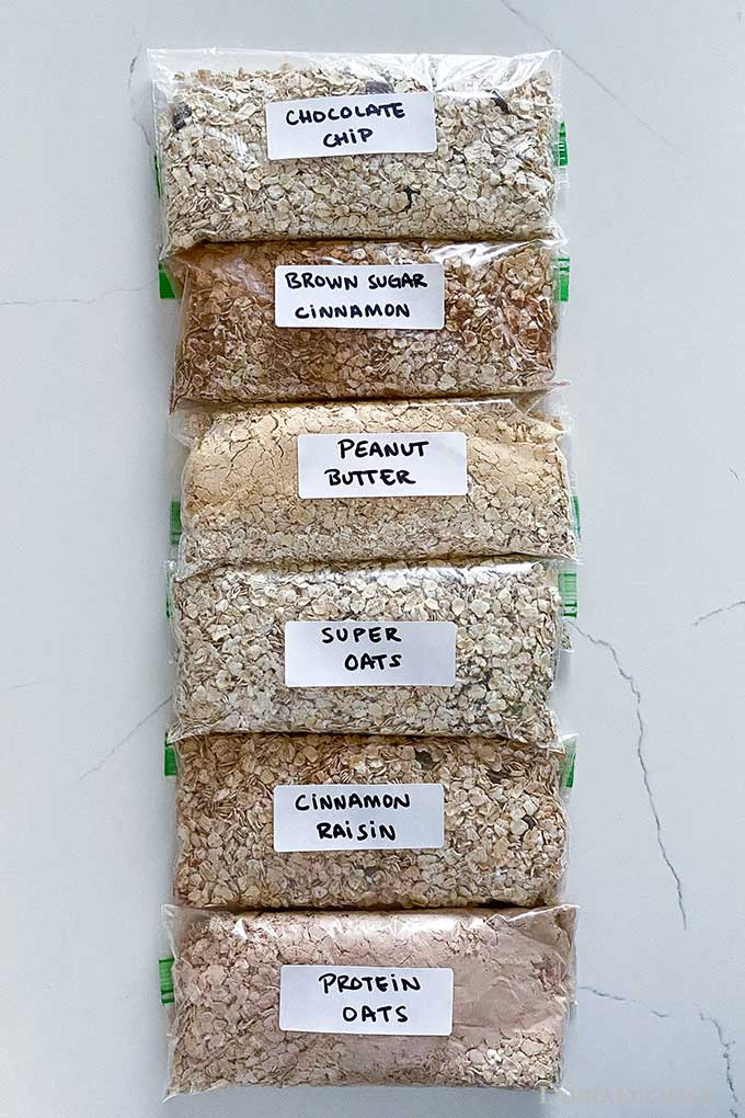 flavored oatmeal packets labeled and lined up on a countertop.