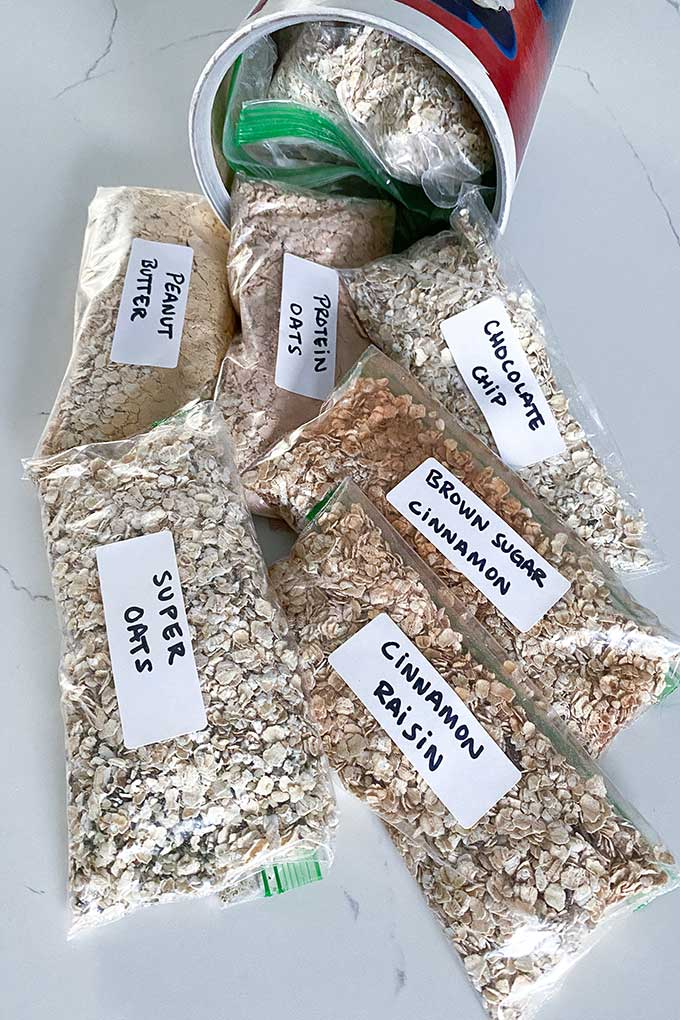 homemade instant oatmeal packets on a counter inside a oatmeal jar