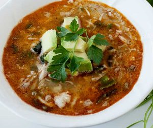 chicken chili topped with avocado