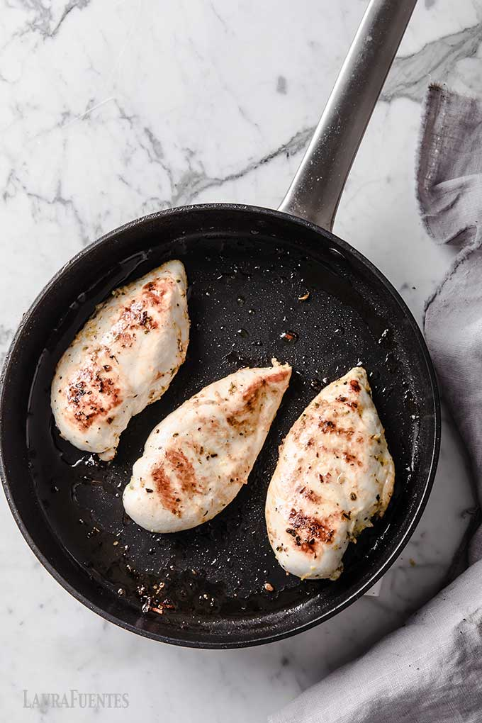three chicken breasts in a skillet