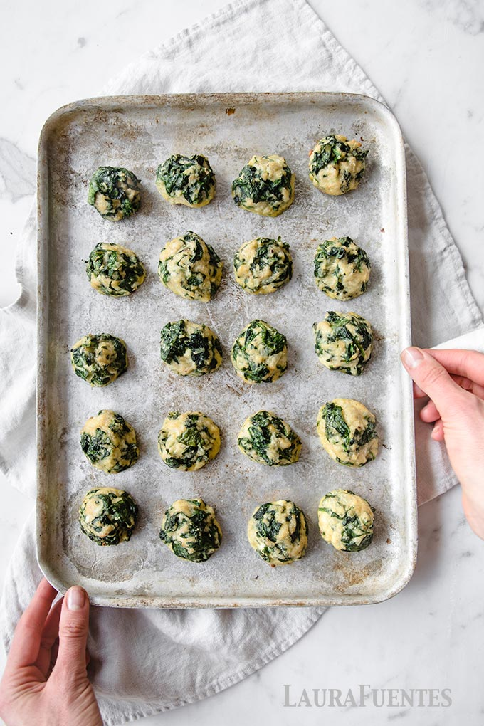 spinach balls on a baking sheet