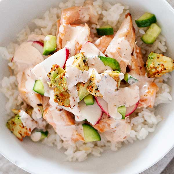 bowl of rice with salmon and spicy mayo