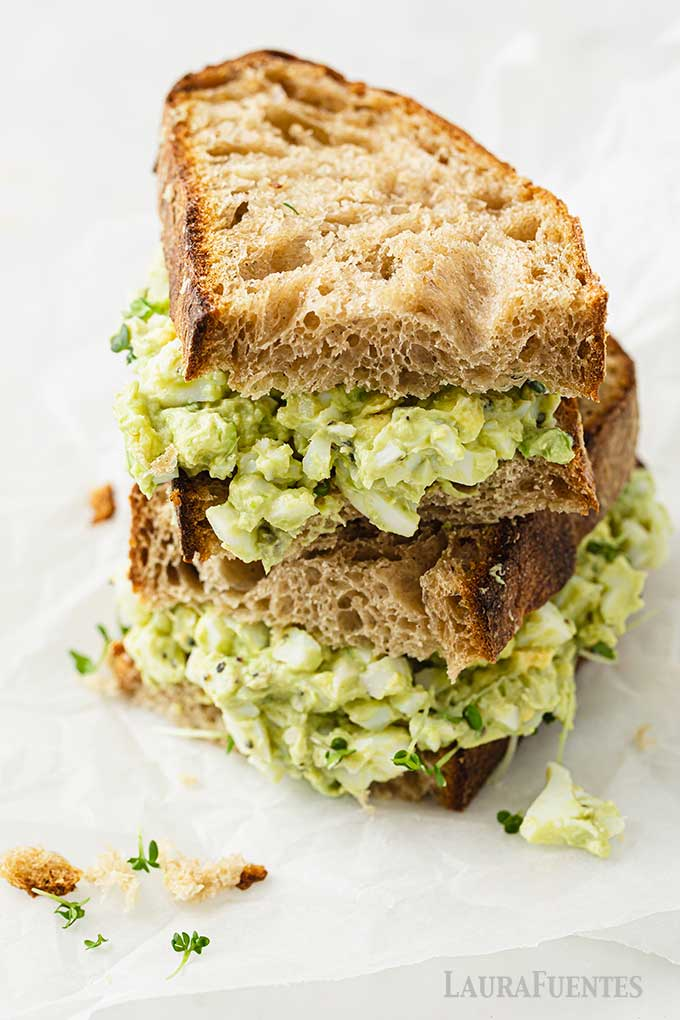 avocado egg salad on thick wheat sandwich bread