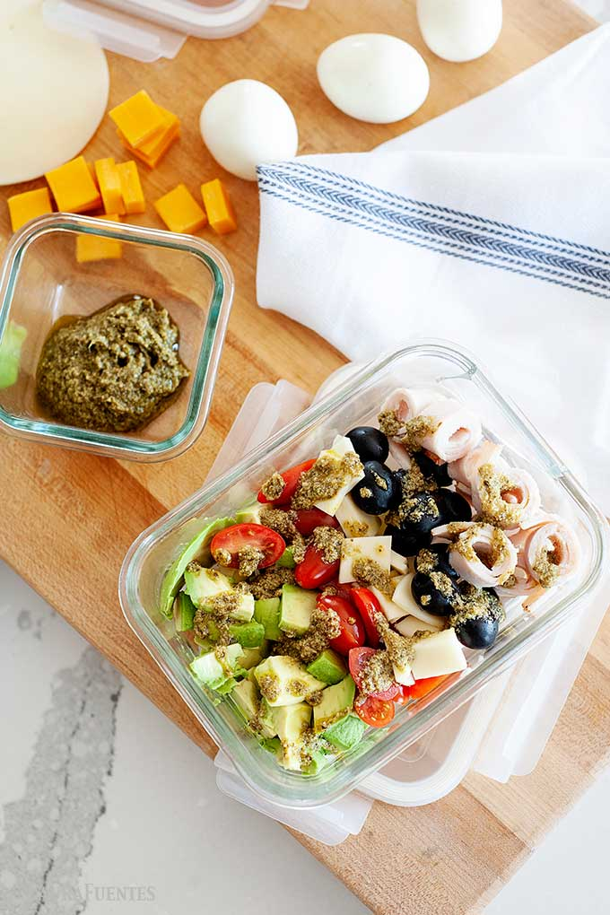 deconstructed salad in a glass lunch container