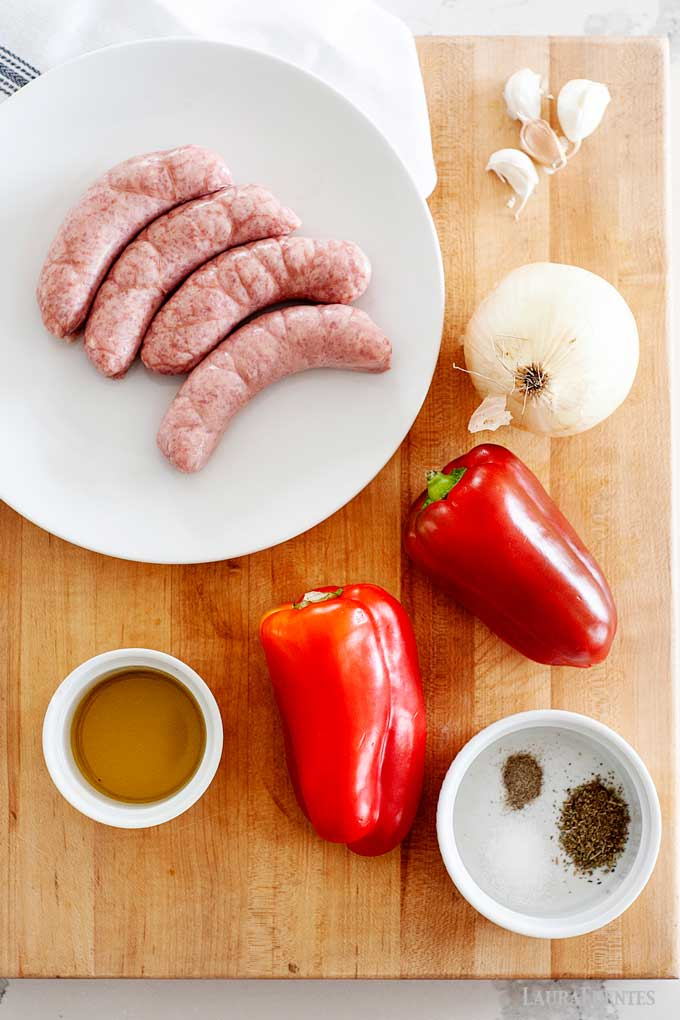 Ingredients for Sausage and Peppers on a cutting board