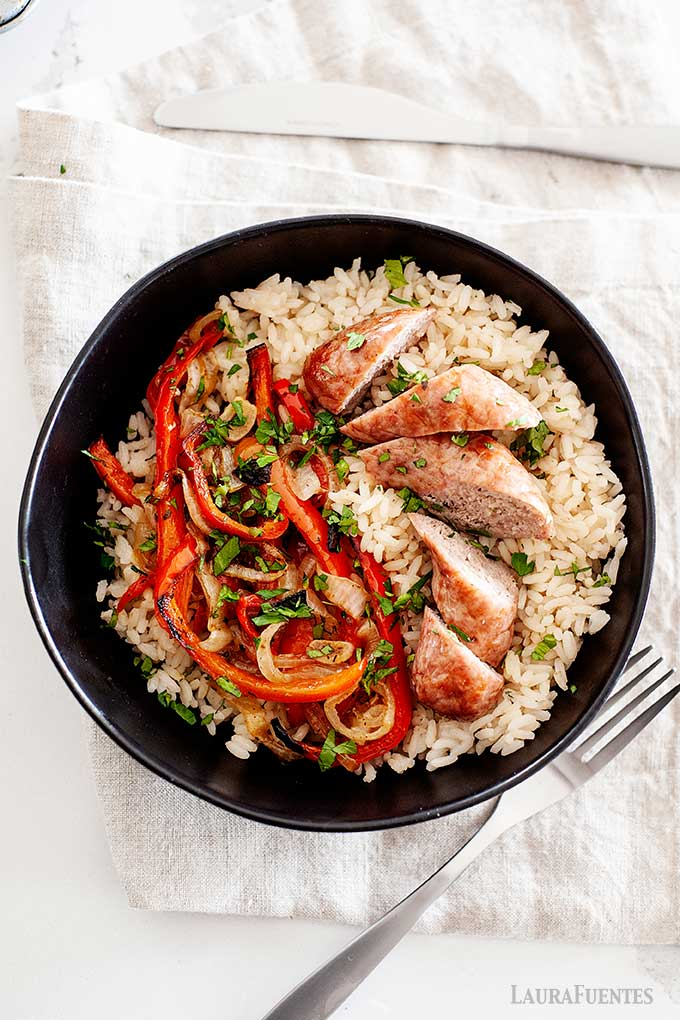sausage and peppers served over rice