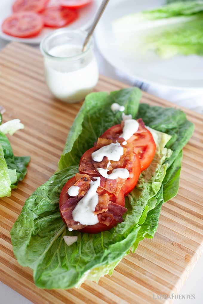 large BLT lettuce wrap on a cutting board