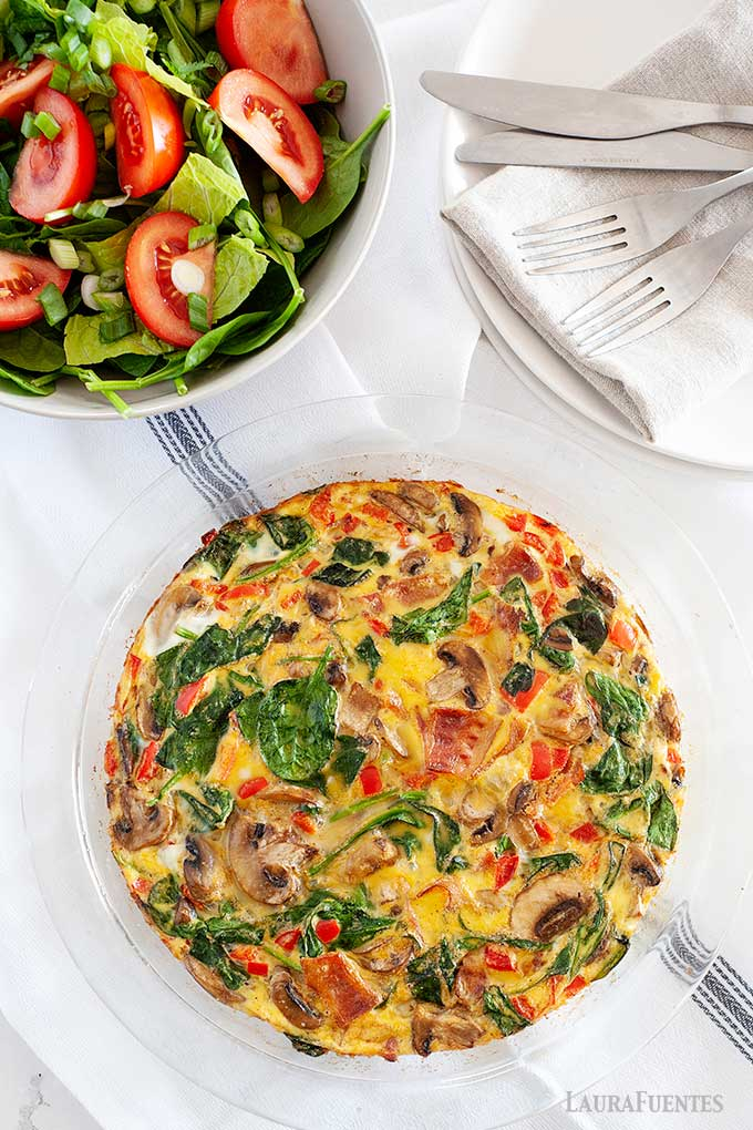spinach bacon frittata in a pan