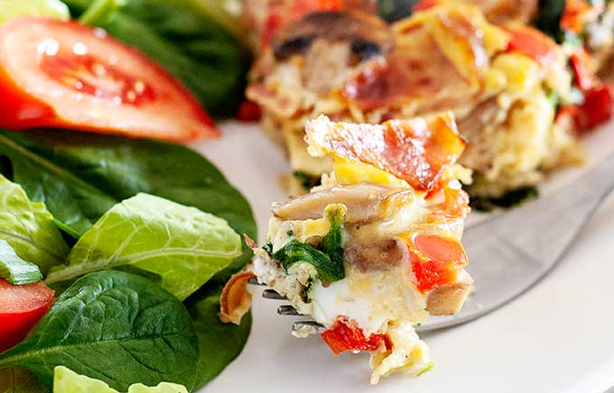spinach bacon frittata bite on a fork