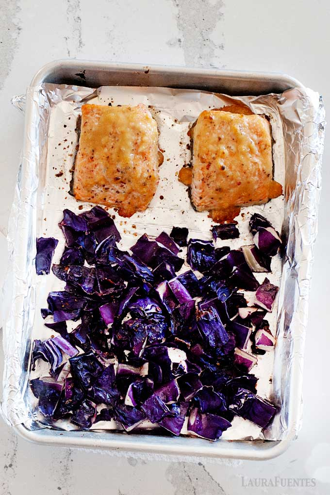 salmon and purple cabbage on a sheet pan