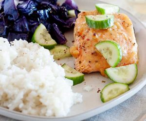 salmon cabbage and rice on a plate