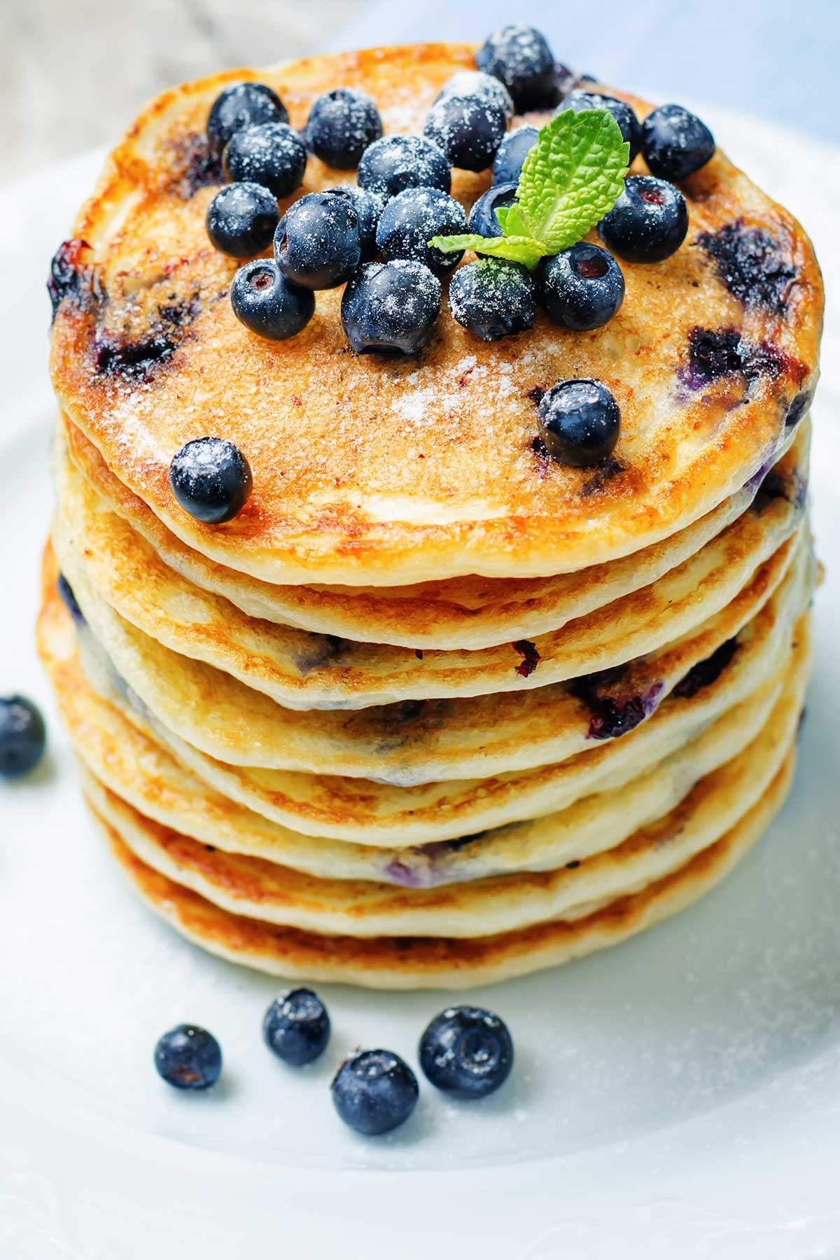 overhead look at blueberry pancakes topped with blueberries