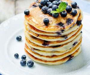 large stack of blueberry pancakes