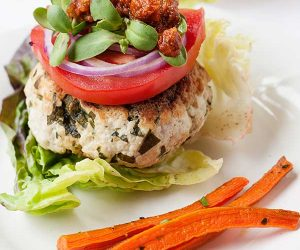 turkey burger on a plate with carrot fries