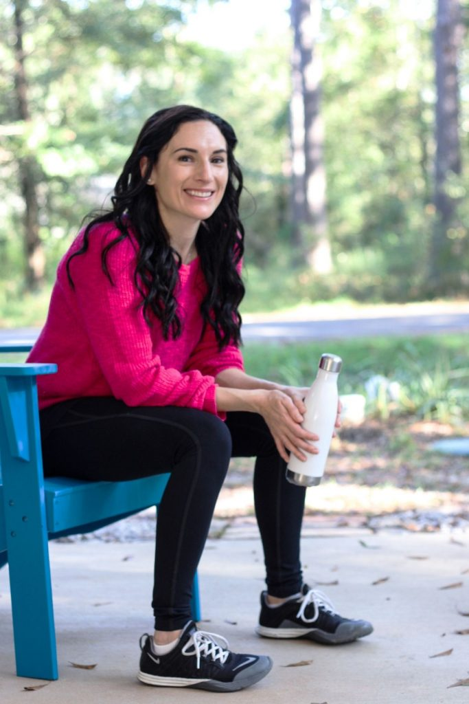 woman sitting outside with water bottle