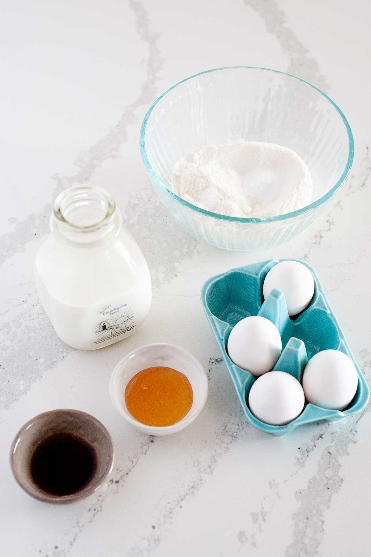 ingredients for coconut flour pancakes laid out on countertop