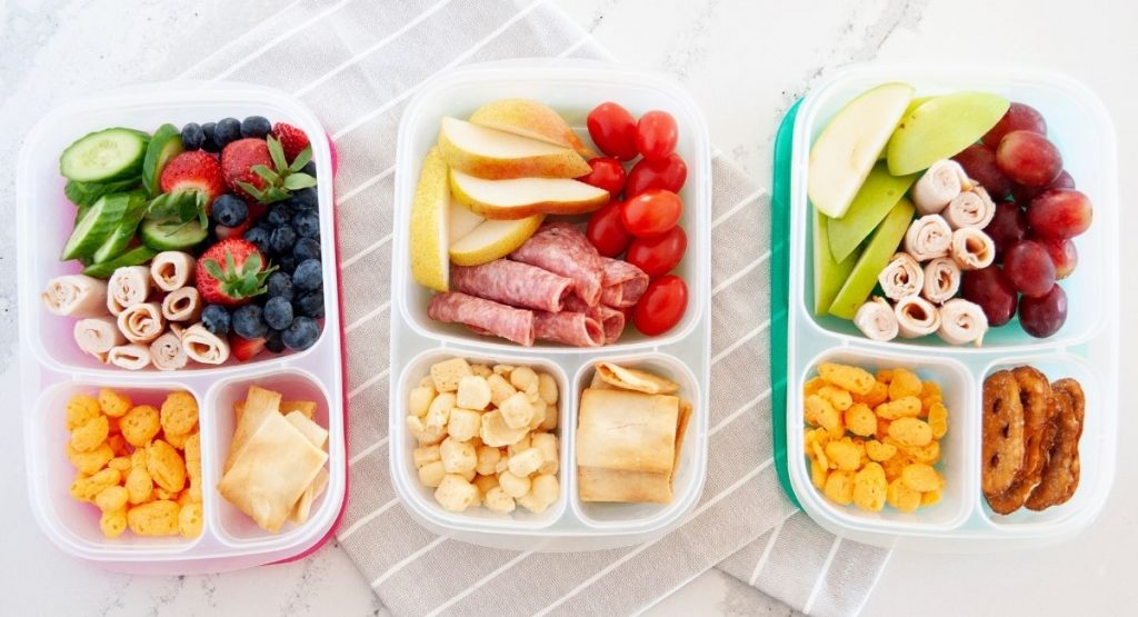 three lunchables for adults lined up side by side