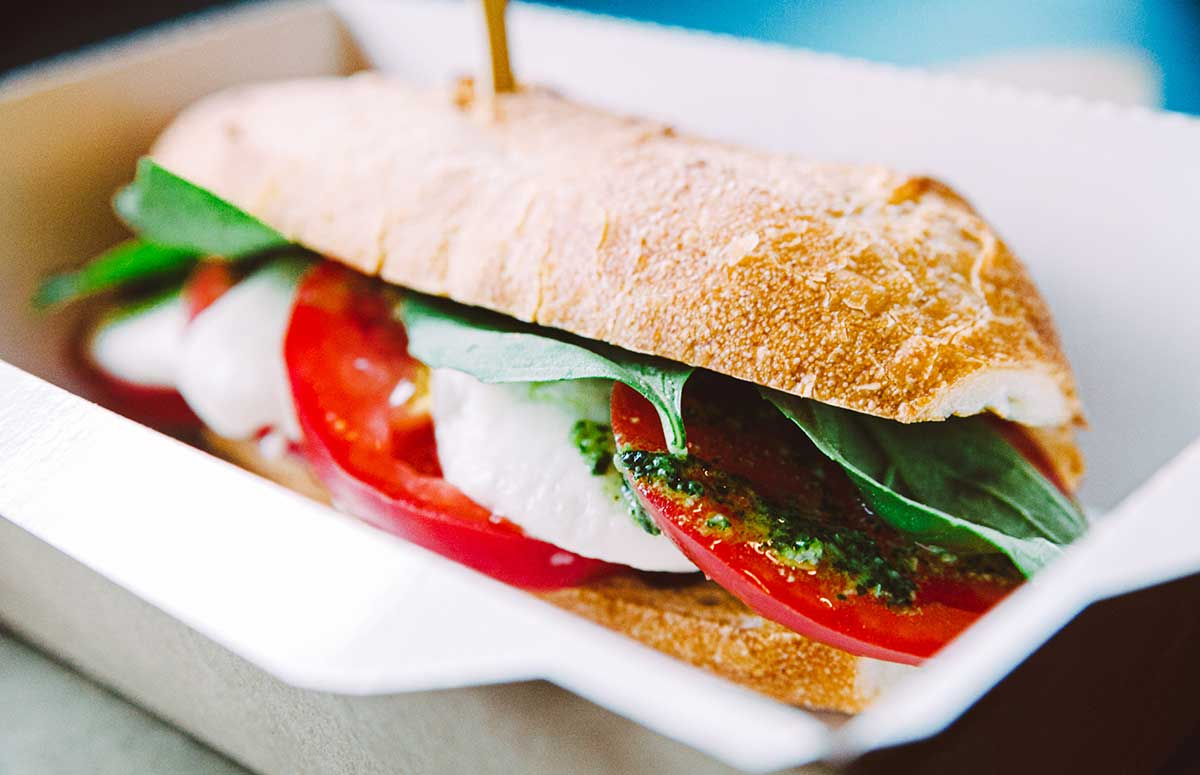 caprese sandwich in a lunch container
