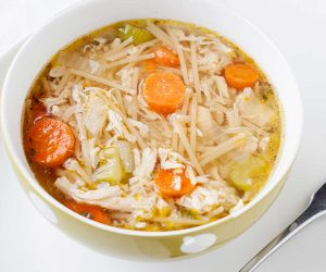 overhead view of a large bowl of turkey or chicken noodle soup