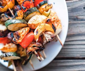 chicken and vegetable skewers on a plate