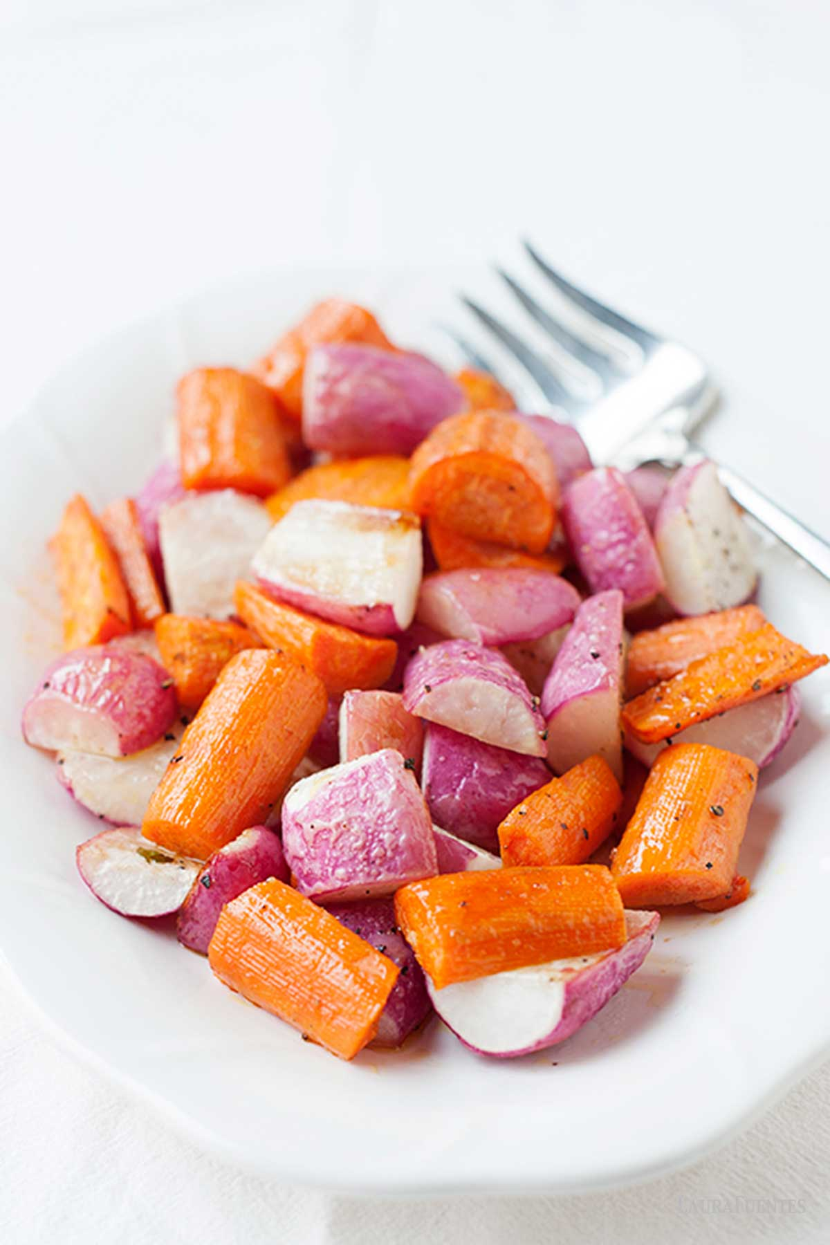 roasted radishes and carrots on a large white plate