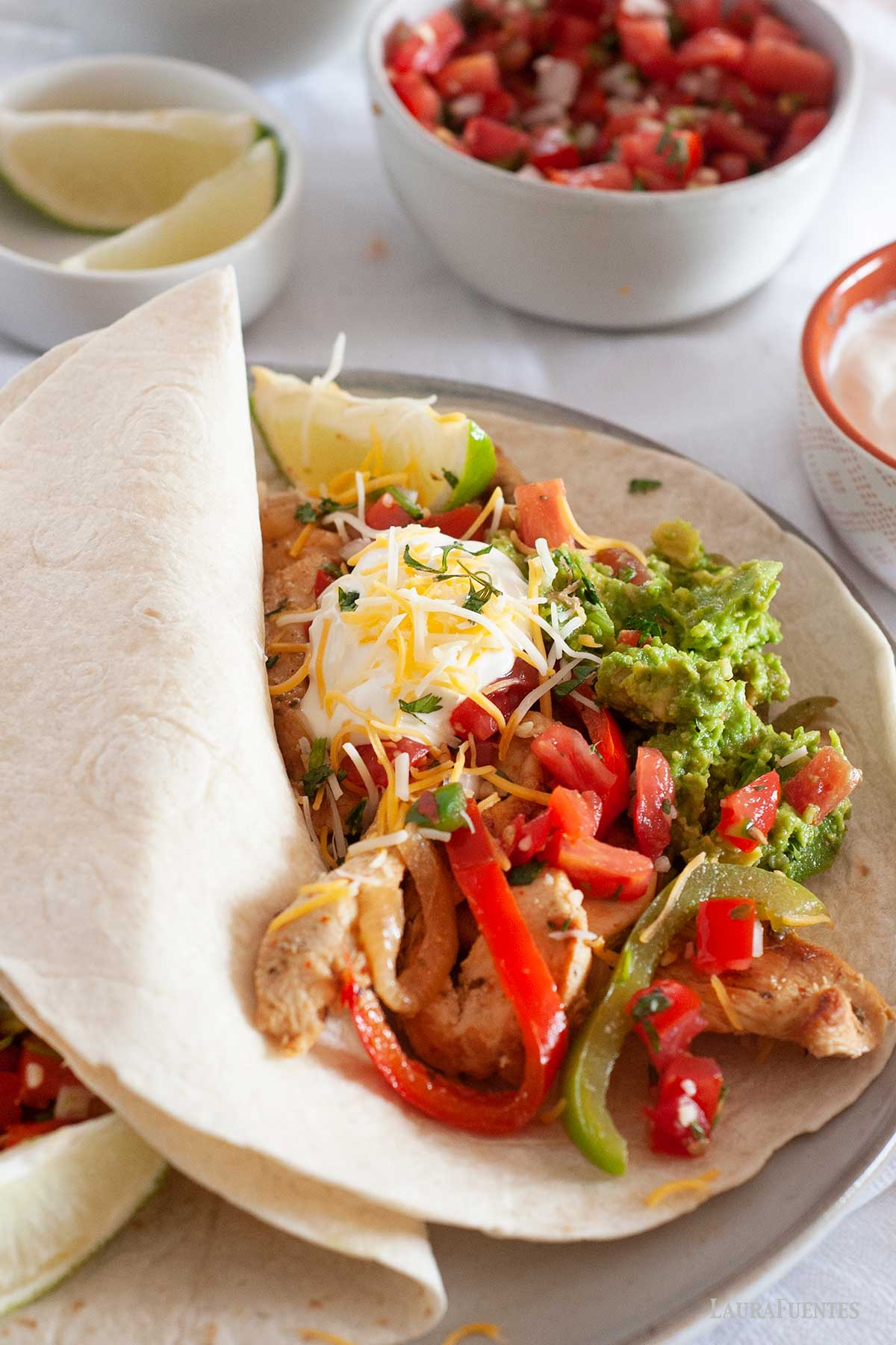 large chicken fajita taco on a plate