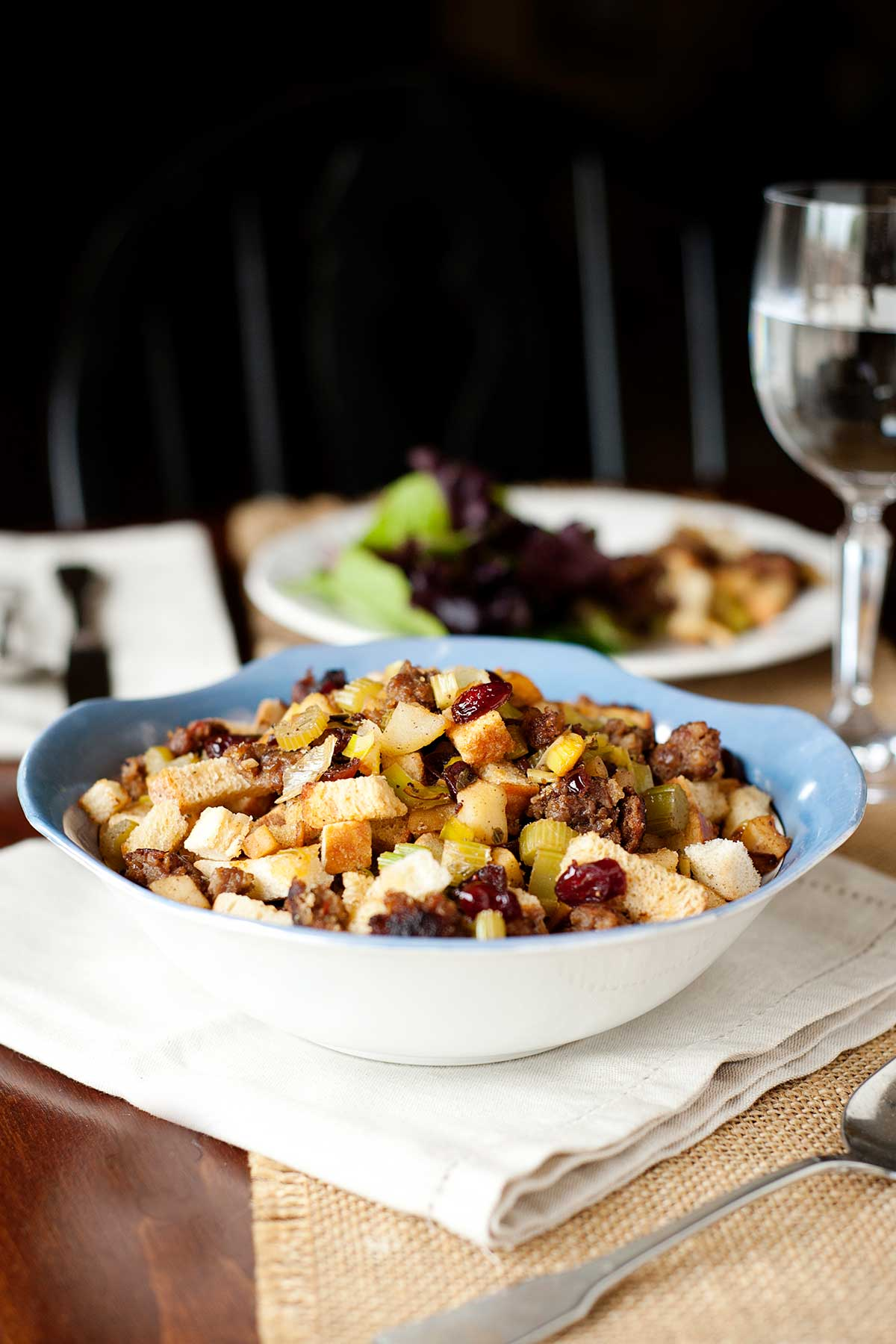 cranberry apple sausage stuffing in a serving dish