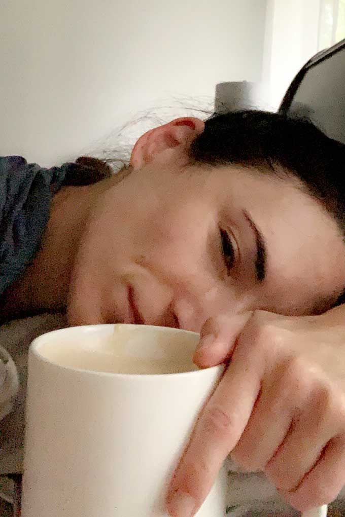 laura in bed with coffee