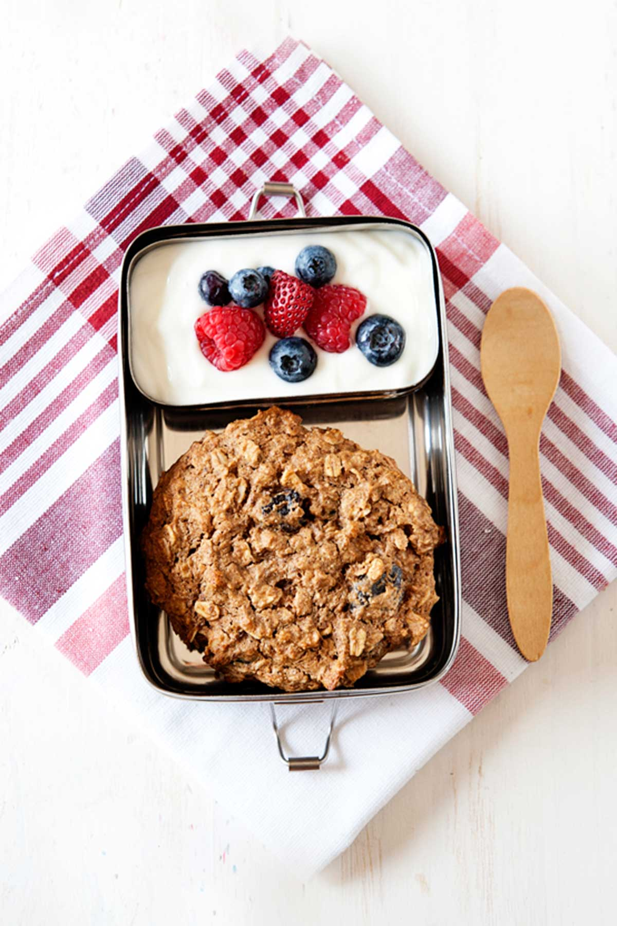 breakfast cookie in a small lunch tin with yogurt