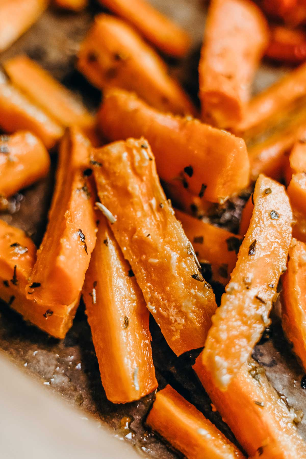 oven roasted carrots sticks on a baking sheet