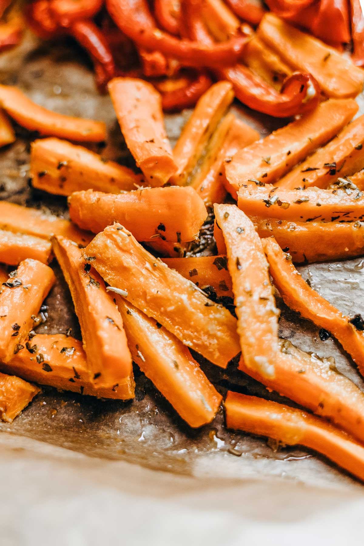 roasted carrot strips on a sheet pan
