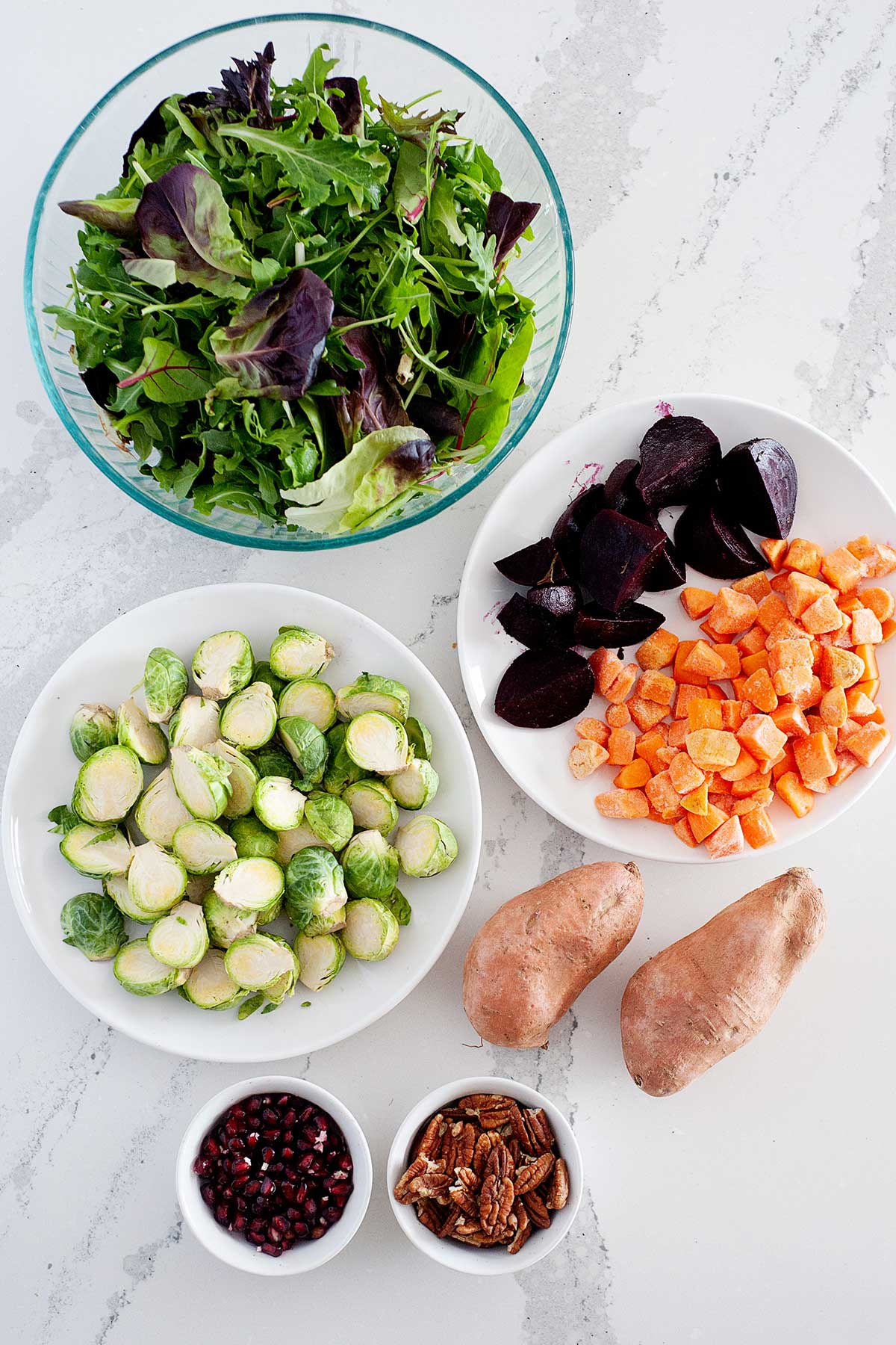 ingredients laid out in bowls for winter salad