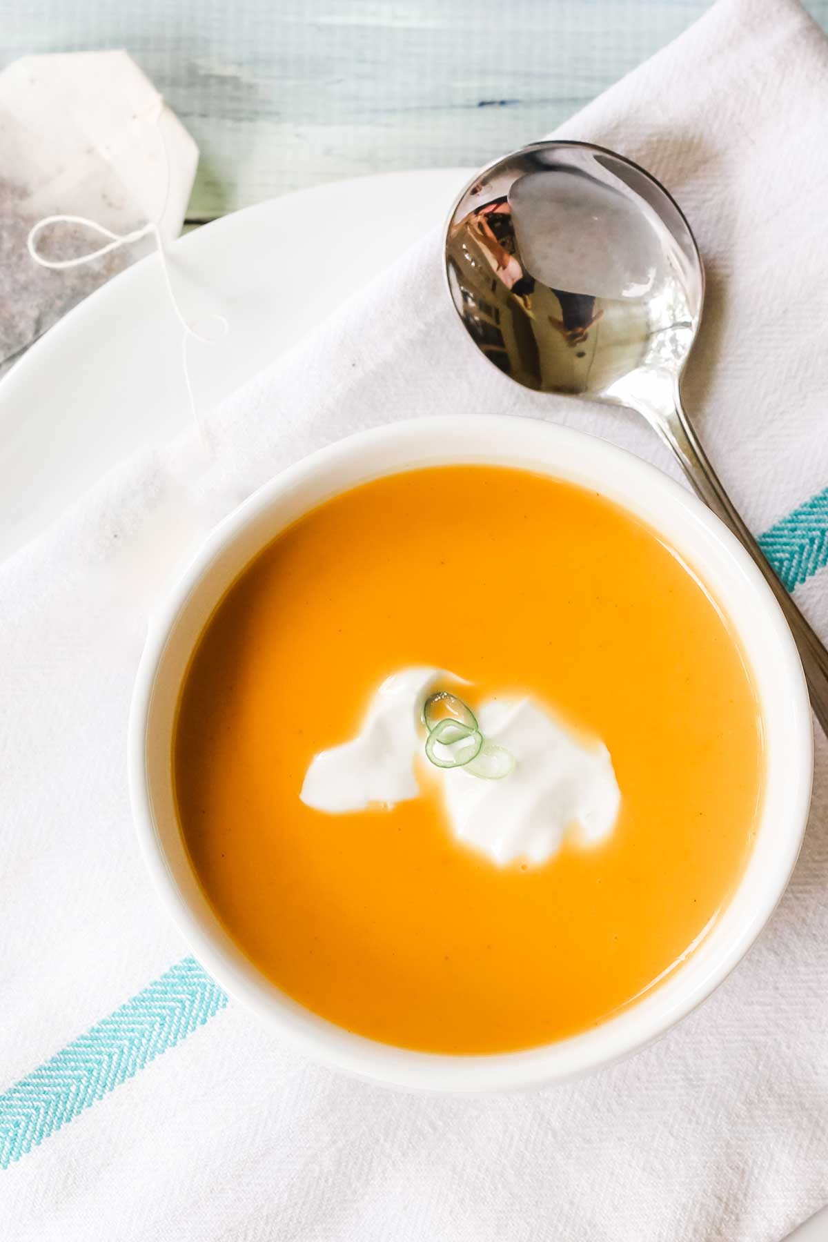 large bowl of orange colored spiced butternut squash soup
